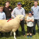 Sean, Patrick, Tom and Tom Dunne (junior), winners of the cheviot ram class with judge William Roberts