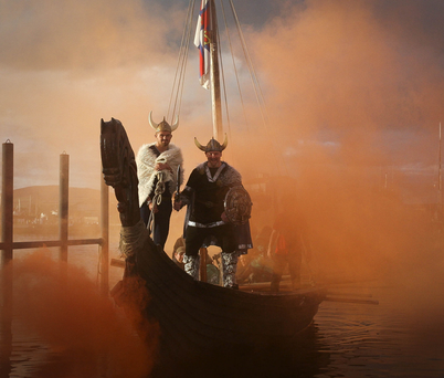 A ship slowly appears through the mist as the Viking raid gets underway