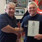 Brendan Copeland (left) presents Barry Spencer with his Certificate of Service