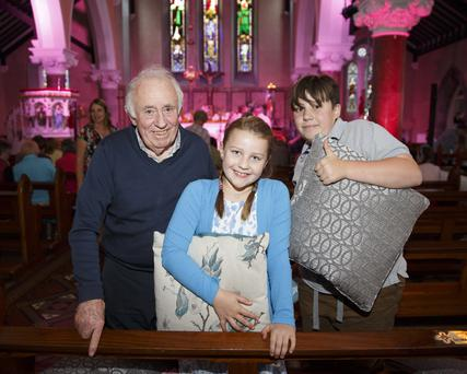 Thomas O'Neill with his grandchildren, Alba and Sean O'Neill, at the concert in St Laurence O'Toole Church