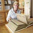 Sheila Clarke leafs through the replica of the Book of Kells