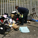 A council waste enforcement officer examining waste dumped on the North Quays in Arklow last week