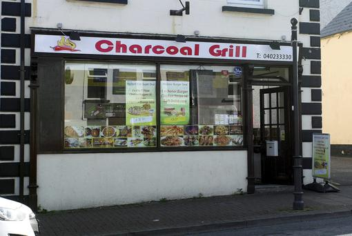 The takeaway worker had the broken bottle held to his neck at the Charcoal Grill in Arklow on Monday night