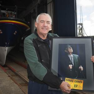 Robert Doyle with his framed photo of Leonard Cohen.