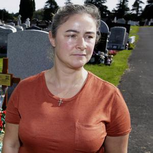 Wendy Cody at her dad Sean Snell's grave in Rathnew Cemetery