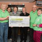 Myles Doyle presents Bill Porter and Rathdrum Cancer support with a cheque