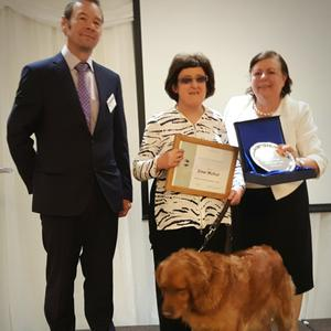Michael Maunsell (Contest Chair), Emer Mulhall and Trudy her guide dog and Jane Mooney (Division Director).