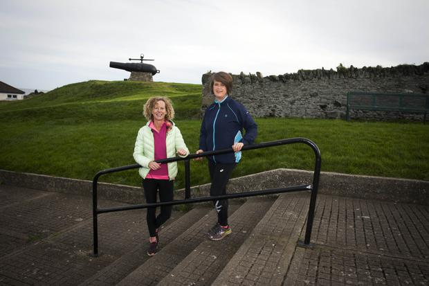 Eithne Walsh and Annmarie Kelly from Inbhear Dee Athletic Club at the steps near the Black Castle.