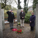 Pete McWilliams from the RAF Association of Ireland branch with Billy Byrne and Sarah Ryan as they lay a wreath during the commemoration