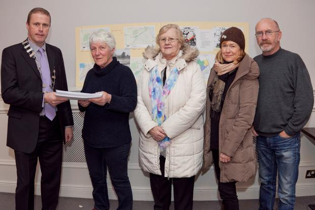 Noleen McManus, Ann Crinion, Herbert Wright, and Joan Conway presenting Cllr Chris Fox with their petition on the Dargle floodplain
