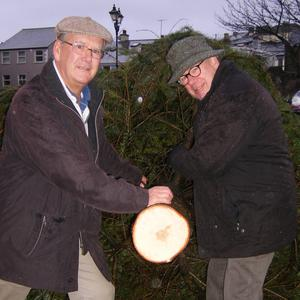 Peter Byrne and Pat Kerr, President Rotary Club of Wicklow, get to work