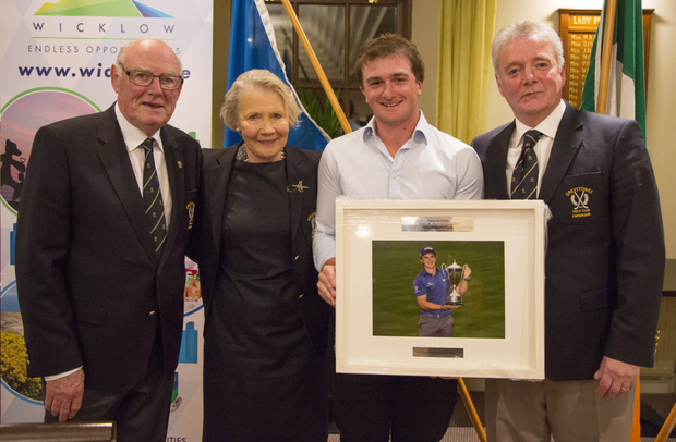 Greystones Golf Club president Seán Woodcock, lady captain Angela Shaw Paul and captain Barry Massey making a presentation to Paul
