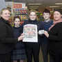 Rita Keating from Centra in Tinahely and Liz Graham present €20 to Alison Hayden, Samantha Wall and Oisin Hayden