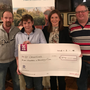 Kalinda Healy (second right) of St Catherine's Association collects a cheque from Thomas Browne, Ann Doyle and Din Keogh