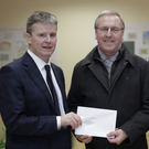 Gerard Roche accepting the award for Most Improved in National Award for Newtownmountkennedy from the cathaoirleach