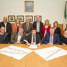 (From left) Andrew O'Sullivan, Victor Lowe, Bridget O'Gorman, Philip Coyne of Coyne Group Construction, Cllr Pat Fitzgerald, cathaoirleach of the Arklow Municipal District Tommy Annesley, Cllr Sylvester Bourke, Breege Kilkenny, Chief Executive of Wicklow County Council Frank Curran, Linda McDonald and Cllr Miriam Murphy at the signing of the contracts
