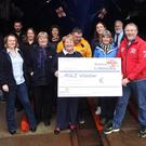 Brian Nolan, Gus Cooney, Colm O Neill, Eoin Gaffney and Mary Aldridge presenting the cheque to members of Wicklow RNLI crew