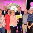 Diane McCoy from McCoys XL, Laragh; Marty Whelan, Angela Magee, who played on her mother Marie's behalf; Marie Ward, Declan Harrington from the National Lottery; William McCoy, selling agent, and Sinead Kennedy