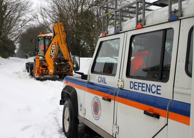 Civil Defence members transporting a patient from Kilmacurragh to St Vincent's Hospital had to rely on the help of a JCB and snow plough to get past snowdrifts of up to two metres.