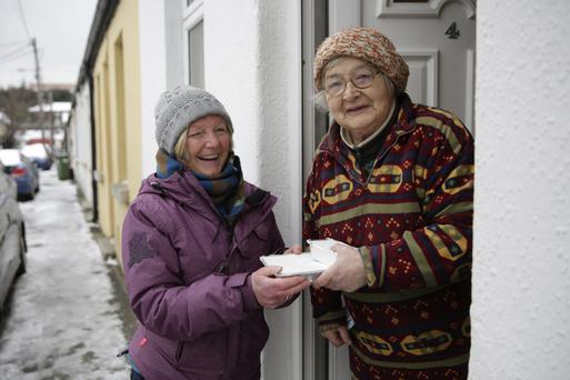 Críona McCarthy makes a delivery to Bridget Curran, the queen of Ardee Street