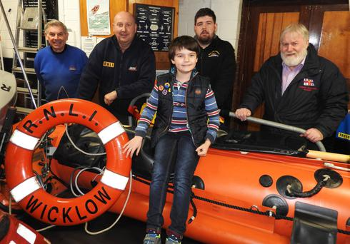 John Hayden, Coxswain Nick Keogh, Ian Heffernan and Des Davitt of Wicklow RNLI with Harry Mascall during his visit to the station (Photo: Wicklow RNLI).