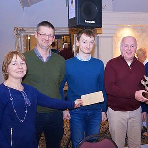 Maria Neilan and Tony Lyons presenting the Lions Club perpetual trophy to Declan McInerney's team