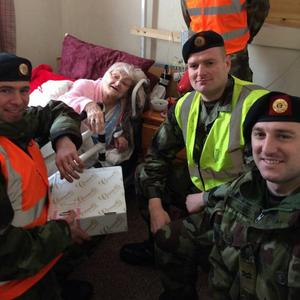 Maura Doyle celebrates her 100th birthday with members of the Defence Forces