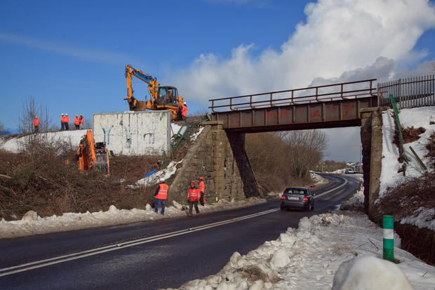 Crews working on the damage to the railway line near Inch