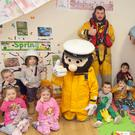 Stormy Sam and RNLI volunteer Dean Mulvihill with teacher Angela Thompson and the students of Jellytots Preschool, who had a PJ Day last Friday to raise money for Mary Nolan Hickey's 'Lap of the Map' and the RNLI