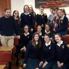 John O'Brien of Dominican College Wicklow with the thirteen students who raise funds
