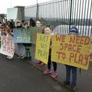 Some of those taking part in the protest outside St Coen's NS in Rathnew on Friday morning