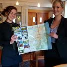Suzy Quirke and Sarah Fortune from the Grand Hotel with the 2018 Tourism Map