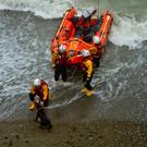 Members of the Wicklow Inshore Lifeboat crew arriving to rescue stranded Winnie on an isolated beach near the Black Castle (Photo: Wicklow RNLI)