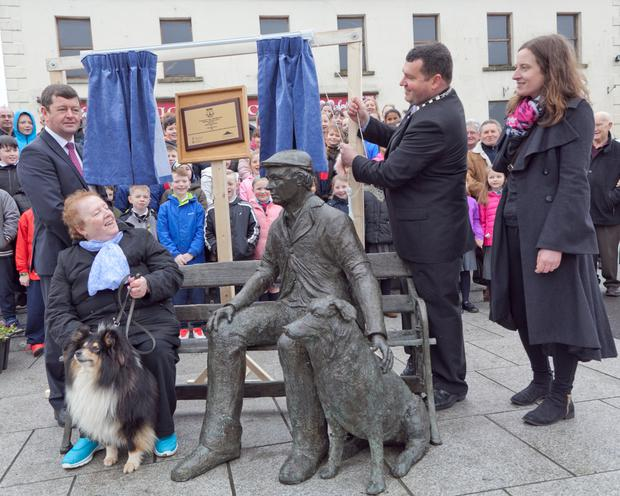 Nora Byrne and her dog Hank had the best seat in the house as the sculpture was officially unveiled by (from left) Cllr Pat Kennedy, Cllr Tommy Annesley and sculptor Ellie McNamara