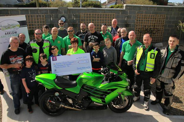 Members of East Coast Roosters MS present a cheque to Arklow Cancer Support