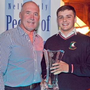 Mark Nicholson accepts the Young Person of the Year Award from Joe Healy