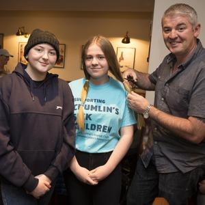 The moment of truth as Zoe Byrne prepares to the get the chop, with her cousin Tori Byrne and uncle Liam Byrne.