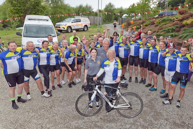 Georgia, David and Heather Froud (Charlie's sister, dad and mum) with the cyclists at the end of the cycle in memory of Charlie Froud