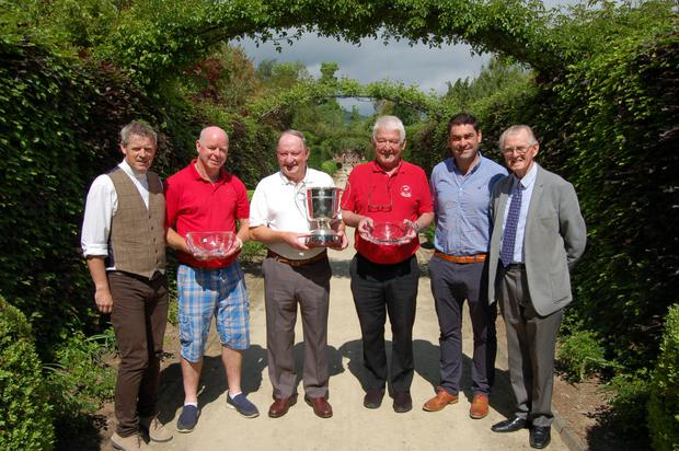 Fr John Daly, PP Kilquade, winning team members Colin O'Neill, Pat O'Neill (captain) and Derek McHugh with Barry Doyle from main sponsor Arboretum Kilquade and Seamus Fitzpatrick, chairman of the organising committee, at the presentation of the Kilquade Cup after the recent competition at Delgany Golf Club