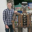 Pictured with the 'robot' are Liam Birmingham and Anthony Nolan. Picture: Pat Moore.