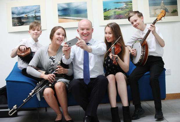 Ryan Harper (13), Eleanor Harper (18), Grace Harper (16) and Cian Harper (13) from the Harper Traditional Band based with CEO of Virgin Media, Tony Hanway (centre)