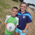 Mustafa al-Sulaiman at his first Cúl Camp with Amy Kavanagh of St Patrick's GAA Club.