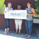 Marcella and Jackie Kinch presenting a cheque for over €2,400 to Karen from Barretstown