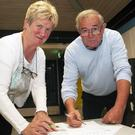 Elizabeth Power and Michael Condren signing the petition