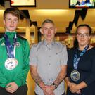 Neil Gordon, Michael Henebery, Michael Flaherty (coach), Jana Galinski and Oisin Byrne celebrating their World Championships success at a get-together in Wexford's Leisuremax