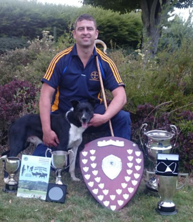 Paul O'Donnell, from Glenealy, with his faithful dog, Tim, with the cups and trophies they've won.