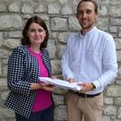 Cllr. Jennifer Whitmore handing over the petition to Rory Brewster of the NTA.