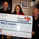 John Hayden and Nick Keogh of Wicklow RNLI accept the cheque for €1,700 from Mary Drumm, Treasurer of Leinster Open Swim, and Robbie Clarke from Eastern Bay Swimming Club.