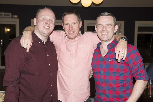 Garda Mick O'Rourke (centre) with Andrew Curry and Brian Farrell at his leaving party in Blessington.