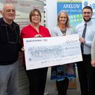 Glen to Glen organiser Fabian Doyle (left) and Sinead Tarmey from Wicklow Hospice Foundation (third from left), with Ciara Murray, Stephen Whelan, Billy Roberts and Jim Mulkern from Arklow Credit Union at the cheque presentation